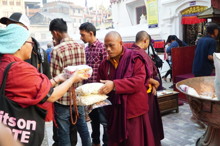 collecting offerings from devotees