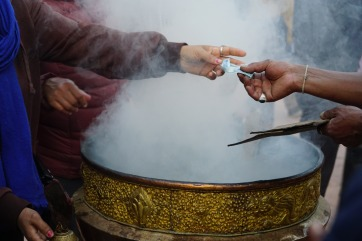 Buying a cup of incense
